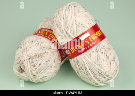 Two 100 gram balls of beige fleck chunky wool - Stock Photo