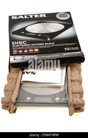 Boxed and packaged Salter disc type electronic kitchen weighing scales - Stock Photo