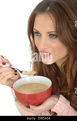 Young Woman Eating Soup - Stock Photo