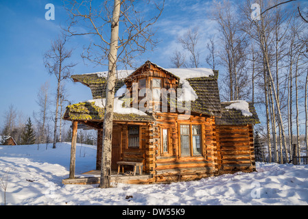 Funky log cabin, , 83 Mile House, Cariboo Region, British Columbia, Canada - Stock Photo