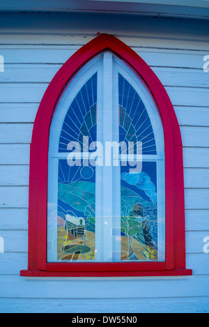 Stained glass window featuring covered wagon and steam locomotive, , St. Albans Church, Ashcroft, British Columbia, - Stock Photo