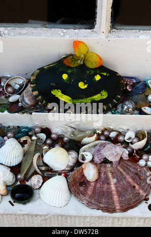 Assorted sea shells on window sill of cottage in Old Town, Hasting, East Sussex, England