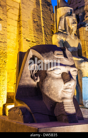Statues of Ramesses II at the entrance to Luxor Temple. - Stock Photo