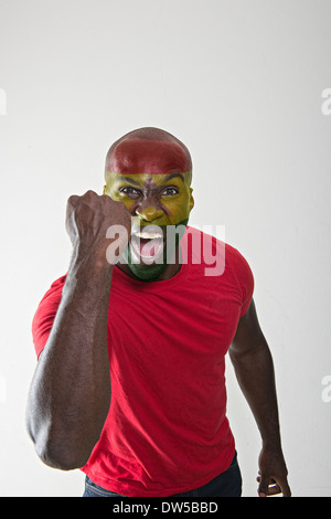 Ghana fan supporting his national team - Stock Photo