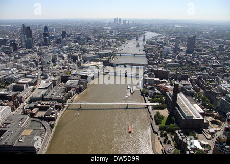 aerial view of the River Thames in London looking east from Tate Modern on Bankside towards the City, with Millennium - Stock Photo