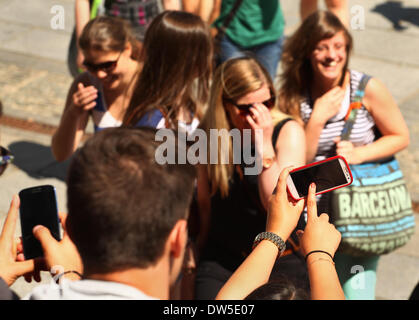 Pupils take pictures with their mobile phones at the Gendarmenmarkt in Berlin, July, 16, 2013. More and more tourists - Stock Photo