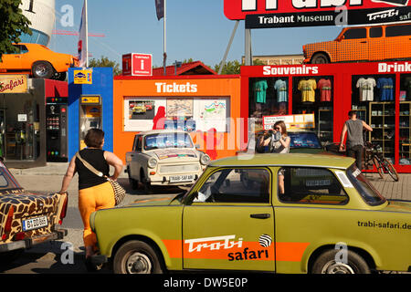 Tourists stand at an East German Trabant car near Checkpoint Charlie in Berlin, September 06, 2013. More and more - Stock Photo