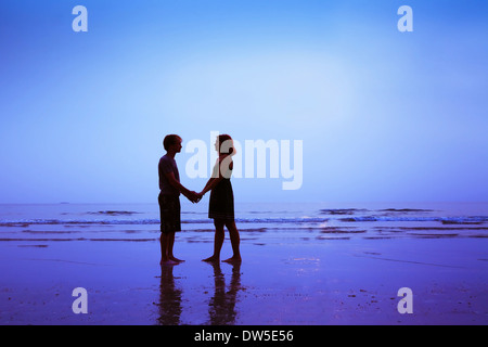 man and woman, happy loving couple on the beach - Stock Photo
