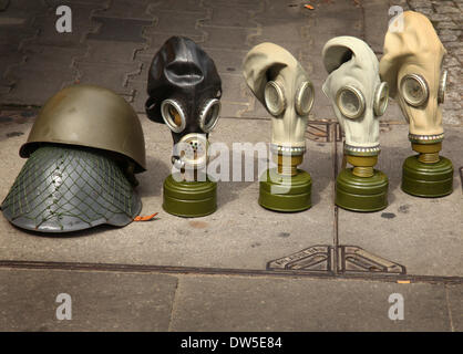 Gas masks and helmets are for sale as souvenirs at Checkpoint Charlie in Berlin, August 09, 2013. More and more - Stock Photo