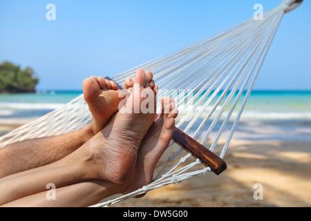 happy couple on the beach in honeymoon - Stock Photo