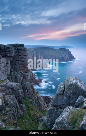 Towering cliffs at Land's End in Cornwall at dawn, England. - Stock Photo