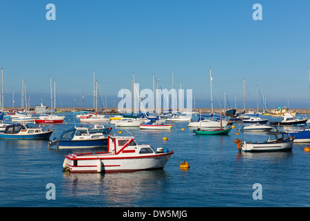 Boats in Brixham marina Devon England on a calm day with blue sky - Stock Photo
