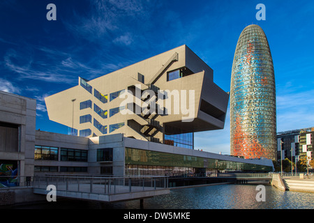 design museum or museu del disseny with torre agbar behind at night barcelona catalonia