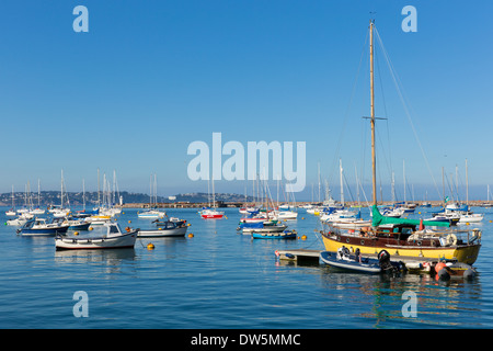 Brixham marina Devon England with boats on a calm day with blue sky - Stock Photo