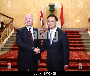 London, UK. 27th Feb, 2014. British Foreign Secretary William Hague (L) shakes hands with Chinese State Councilor - Stock Photo