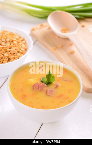 Pea soup in a white bowl - Stock Photo