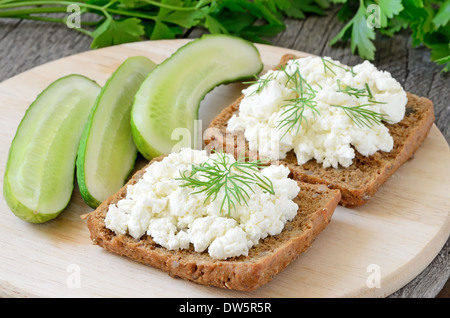 Sandwiches with curd cheese and cucumber slices - Stock Photo