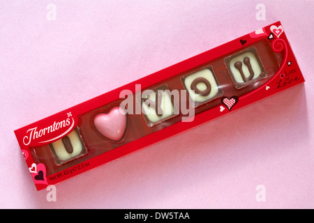 Thorntons I love you individual chocolates isolated on pink background - ideal present for Valentine day, Valentines - Stock Photo
