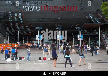 Spain, Catalonia, Barcelona, Mare Magnum mirrored glass modern shopping mall. - Stock Photo