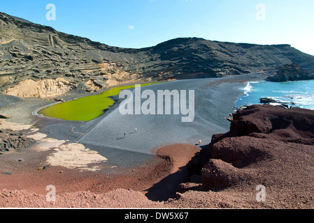 El Golfo, a volcanic lagoon on the west coast of Lanzarote Canary Islands Spain - Stock Photo