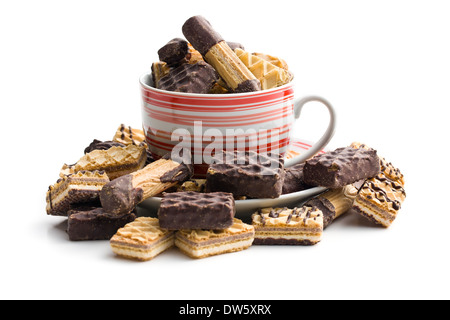 mix of sweet cookies in coffee mug on white background - Stock Photo