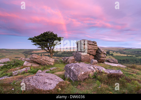 Dawn rainbow above Holwell Tor, Dartmoor, Devon, England. Summer (August) 2013. - Stock Photo