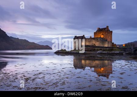 Twilight over Eilean Donan Castle on Loch Duich, Dornie, Scotland. Winter (November) 2013. - Stock Photo