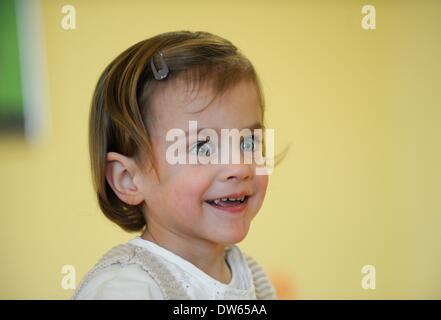 Fulda, Germany. 18th Feb, 2014. Frieda smiles during a visit at Fulda Hospital in Fulda, Germany, 18 February 2014. - Stock Photo