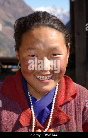 Tibetan woman in the village of Lho, Nepal. - Stock Photo