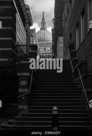 A flight of stairs leading up to a view of St Paul's Cathedral. - Stock Photo