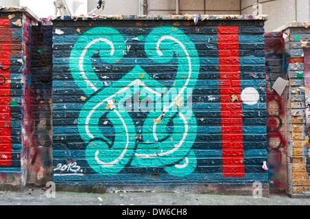 Graffiti on street walls in the Hongdae district of Seoul, South Korea.