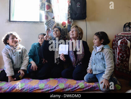Daniela Schadt, the partner of German President Gauck, visits a Syrian refugee family from Damascus in Amman, Jordan, - Stock Photo