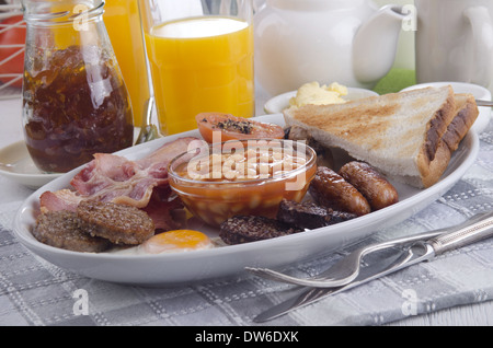 traditional irish breakfast with bacon, pudding, sausage, toast, egg and bean - Stock Photo