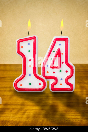 Burning birthday candles number 14 - Stock Photo