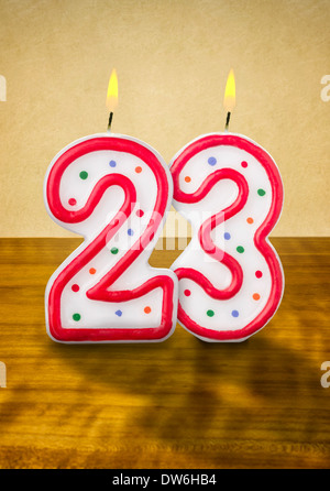 Burning birthday candles number 23 - Stock Photo