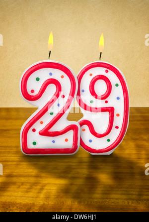 Burning birthday candles number 29 - Stock Photo