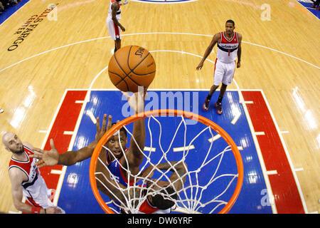 Philadelphia, Pennsylvania, USA. March 1, 2014: Philadelphia 76ers power forward Thaddeus Young (21) puts up the - Stock Photo