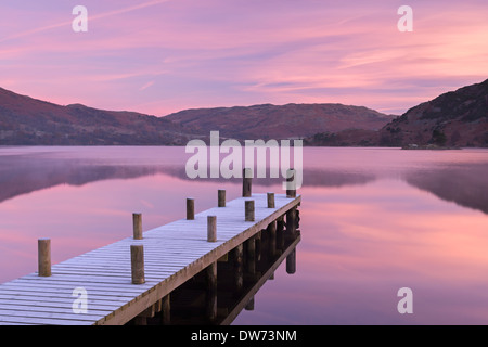 Frosty wooden jetty on Ullswater at dawn, Lake District, Cumbria, England. Winter (November) 2013. - Stock Photo