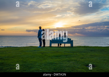 People viewing the sunset from Law Street Park. San Diego, California, United States. - Stock Photo