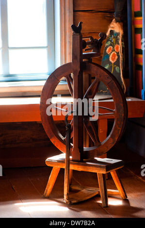 Wooden spinning installation in a cottage - Stock Photo