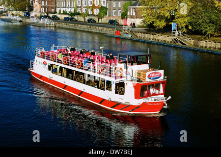 Sunlit tourist cruise riverboat on river Ouse York north Yorkshire England Europe - Stock Photo