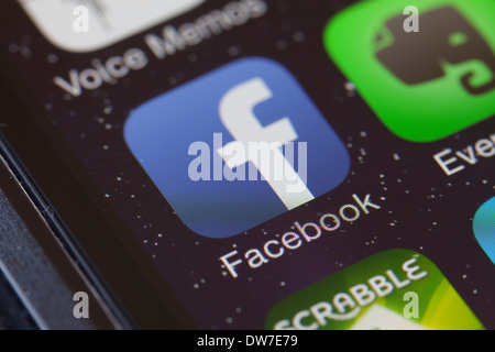 Facebook app icon on mobile phone. - Stock Photo