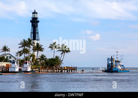 Completed in 1907, the historic 167 foot tall Hillsboro Inlet Lighthouse sits on the point of land on the northeast - Stock Photo