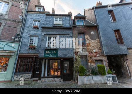 Honfleur is characterized by its houses with slate-covered frontages, - Stock Photo