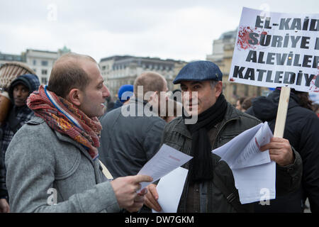 London,  UK. 2nd March, 2014. Protester handing out leaflets about the massacre in the Alevi village of Maan in - Stock Photo