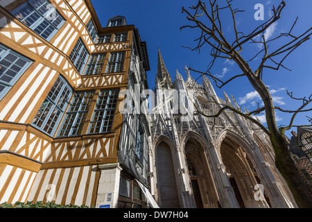 Half timbered house in Place Barthélémy and the  Church of Saint-Maclou - Stock Photo