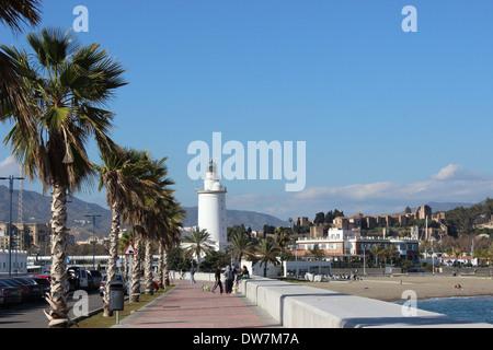 The lighthouse ('farola') and Malagueta Beach, adjoining the Port of Malaga. - Stock Photo