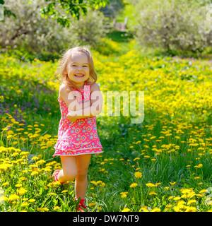 Little girl in the park - Stock Photo