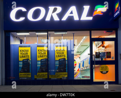 Gamble responsibly posters showing national gambling helpline number in Coral Bookmakers. - Stock Photo