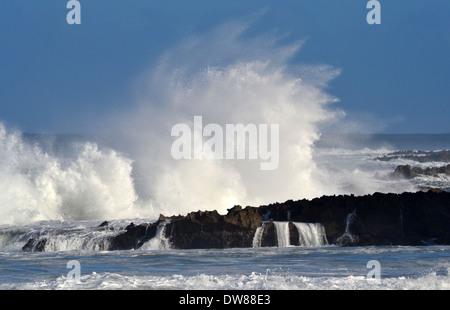 Giant waves breaking at shore in Waimea Bay, North Shore of Oahu, Hawaii, USA - Stock Photo